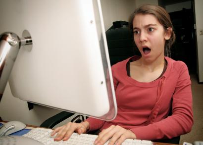 Shocked woman at computer screen