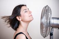 Girl in front of fan