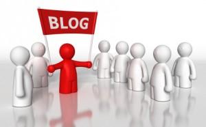 Blogger holding up Blog sign