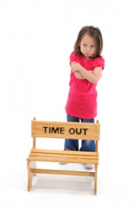 Girl standing behind chair that reads Time Out