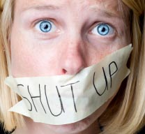 "Girl with ""shut up"" tape over her mouth"