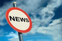 """sign agaisnt a blue sky that says """"news"""""""