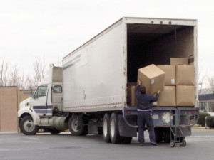 man removing boxes from back of truck