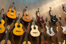 guitar collection on a wall