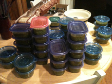 plastic containers of pesto ready for the freezer
