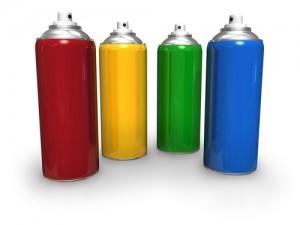 red, yellow, green and blue spray cans
