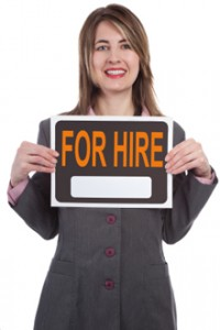 """publicist holding """"for hire"""" sign"""