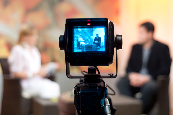 Camera on the set of a TV talk show