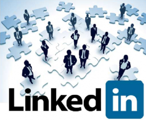 Business people standing atop pieces of a jigsaw puzzle with LinkedIn logo