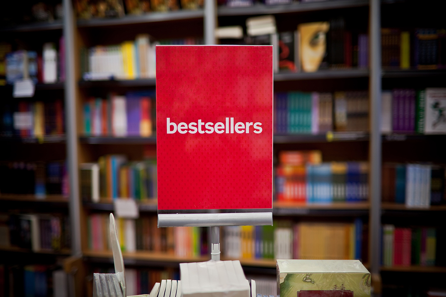 "red ""bestsellers"" sign in book store"