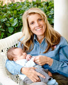 Adoption expert and author Mardie Caldwell holding an adopted baby