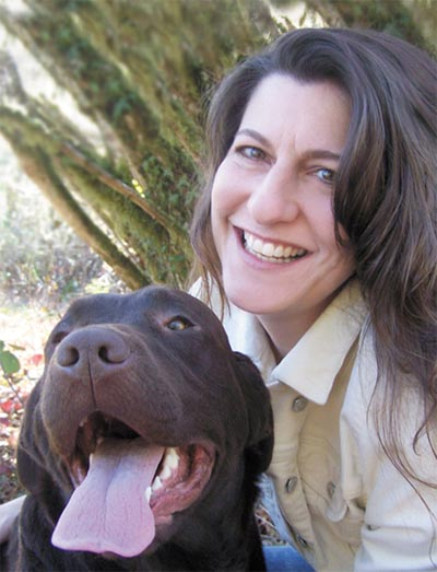 Publisher Nancy Cleary and her dog Book