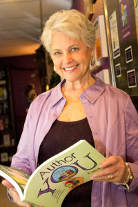 Judith Briles holding her book